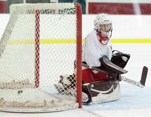 A shot gets by Greenwich high school goalie Dart Freccia in a girls ice hockey game against New Canaan high school played at the Dorothy Hamill Skating Rink, Greenwich, CT on Monday January 7th, 2013. Photo: Mark Conrad / Stamford Advocate Freelance