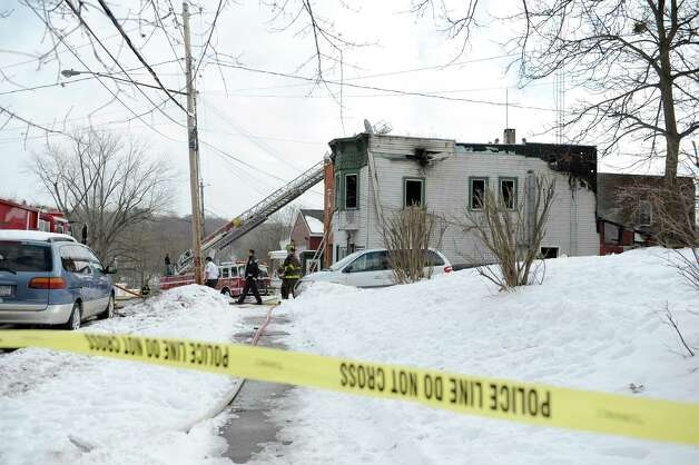 Firefighters work at the scene of a structure fire at 40 Partition St. on Monday, Jan. 7, 2013 in Rensselaer, NY.  The building houses Win's Market on the first floor.  (Paul Buckowski / Times Union) Photo: Paul Buckowski  / 00020684A