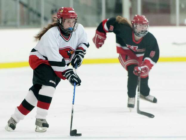 Greenwich high school's Sara Schectman moves the puck up ice in a girls ice hockey game against New Canaan high school played at the Dorothy Hamill Skating Rink, Greenwich, CT on Monday January 7th, 2013. Photo: Mark Conrad / Stamford Advocate Freelance