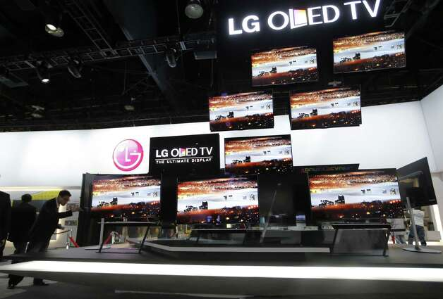 LG OLED televisions are displayed at the LG booth at the International Consumer Electronics Show in Las Vegas on  Monday. Ultra-HD sets come as small as new models from LG and Sony, which stretch 55 inches diagonally. Photo: Jae C. Hong, STF / AP