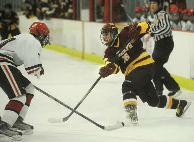 St. Joseph's Ryan Corcoran fires a shot from the point during the first period of their FCIAC hockey matchup with New Canaan at the Darien Ice Rink on Monday, January 7, 2013. Photo: Brian A. Pounds