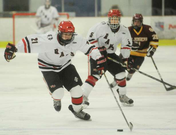 New Canaan's Parker Lewis races the puck up ice in the second period of their FCIAC hockey matchup with St. Joseph at the Darien Ice Rink on Monday, January 7, 2013. Photo: Brian A. Pounds
