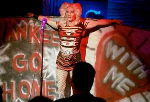 "Hedwig 2.jpg Arturo Galster is one of eight men and women playing the role of Hedwig in Boxcar Theatre's re-imagined production of the rock musical ""Hedwig and the Angry Inch"" running through Aug. 10. Photo by Peter Liu"