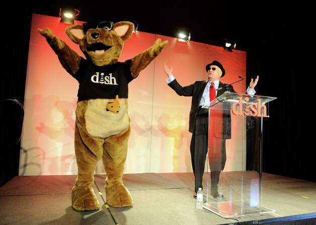 DISH Network President and CEO Joe Clayton (R) and DISH Networks mascot Hopper arrive at a press event at the Mandalay Bay Convention Center for the 2013 International CES on January 7, 2013 in Las Vegas, Nevada. Photo: David Becker, Getty Images / 2013 Getty Images