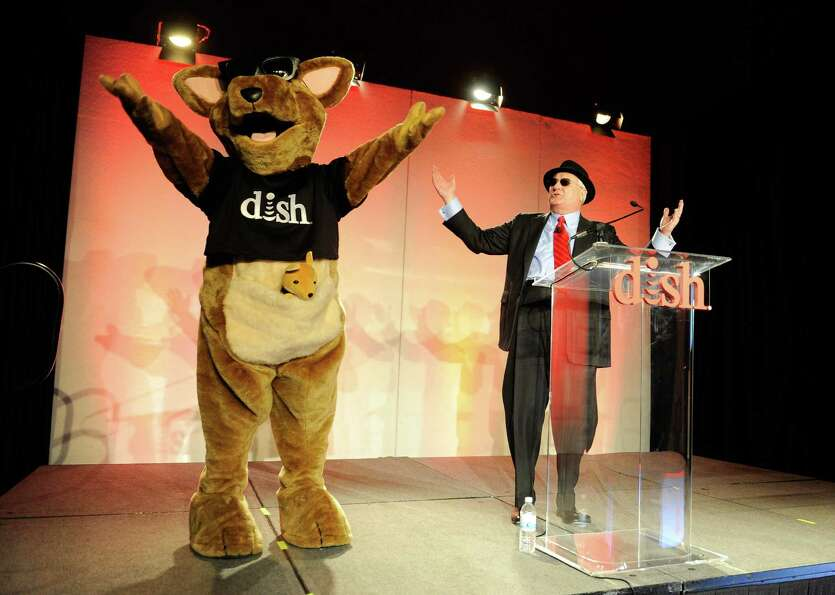 DISH Network President and CEO Joe Clayton (R) and DISH Networks mascot Hopper arrive at a press eve