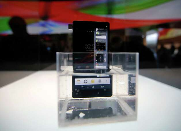 Sony's new Xperia Z smartphone is displayed in water at the Sony booth at the International Consumer Electronics Show in Las Vegas, Monday, Jan. 7, 2013. The 2013 International CES gadget show, the biggest trade show in the Americas, is taking place in Las Vegas this week. (AP Photo/Jae C. Hong) Photo: Jae C. Hong, Associated Press / AP