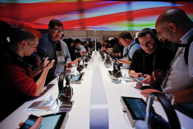 People check out Sony's new Xperia Z smartphones after a news conference at the International Consumer Electronics Show in Las Vegas, Monday, Jan. 7, 2013. The 2013 International CES gadget show, the biggest trade show in the Americas, is taking place in Las Vegas this week. (AP Photo/Jae C. Hong) Photo: Jae C. Hong, Associated Press / AP