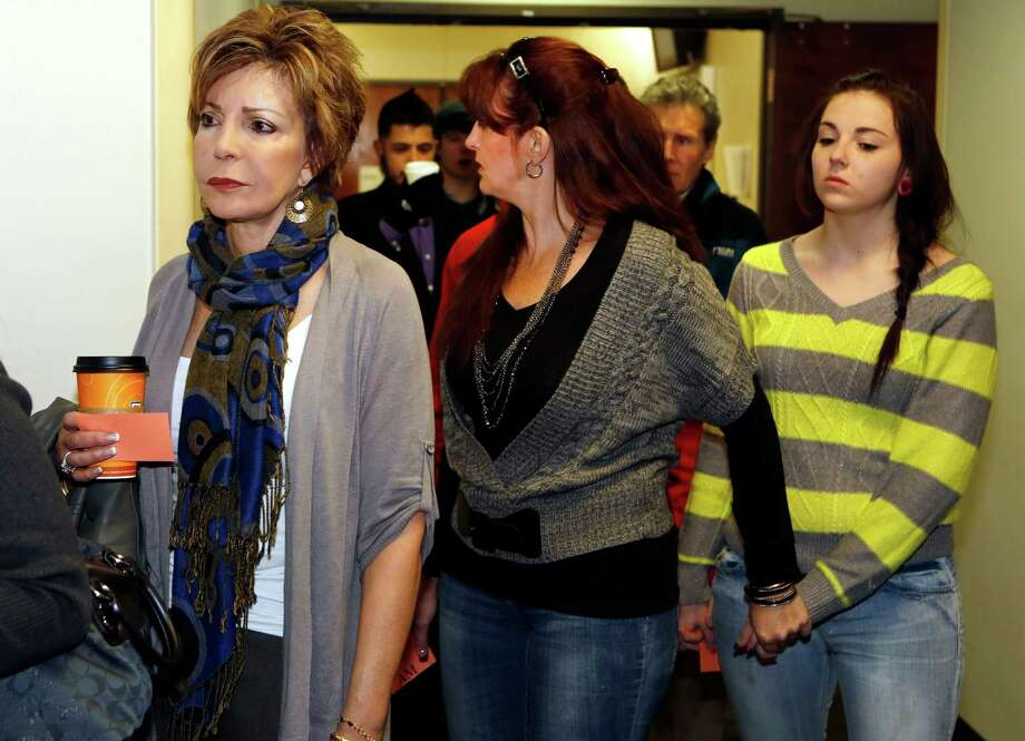 Family members and victims line up to get into court for a preliminary hearing for Aurora theater shooting suspect james Holmes at the courthouse in Centennial, Colo., on Monday, Jan. 7, 2013.  Holmes is charged with more than 160 counts, including murder and attempted murder after a bloody rampage in a Colorado movie theater left 12 people dead.  (AP Photo/Ed Andrieski) Photo: Ed Andrieski