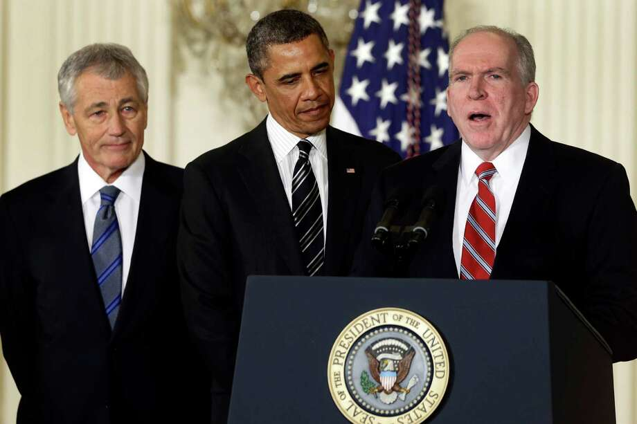 President Barack Obama and his choice for Defense Secretary, former Nebraska Sen. Chuck Hagel, left, listen as he choice for new CIA Director, current Deputy National Security Adviser for Homeland Security and Counterterrorism, John Brennan, speaks during the announcement in the East Room of the White House in Washington, Monday, Jan. 7, 2013 in Washington.  (AP Photo/Charles Dharapak) Photo: Charles Dharapak