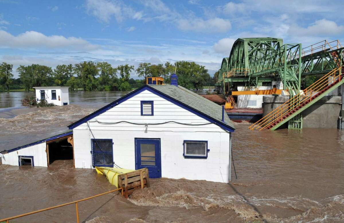 Flood waters engulf the lock house at Lock 8 on the Mohawk River Thursday Sept. 08, 2011. The Federal Emergency Management Agency wants to rebuild eight Mohawk River dams along a 40-mile stretch of the Erie Canal, so dams can move out of the way to let the river flow unimpeded when future flood waters threaten. (John Carl D'Annibale / Times Union archive)