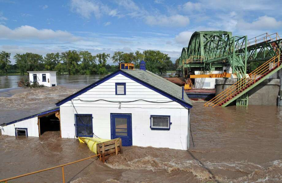 Flood waters engulf the lock house at Lock 8 on the Mohawk River Thursday Sept. 08, 2011.  The Federal Emergency Management Agency wants to rebuild eight Mohawk River dams along a 40-mile stretch of the Erie Canal, so dams can move out of the way to let the river flow unimpeded when future flood waters threaten. (John Carl D'Annibale / Times Union archive) Photo: John Carl D'Annibale