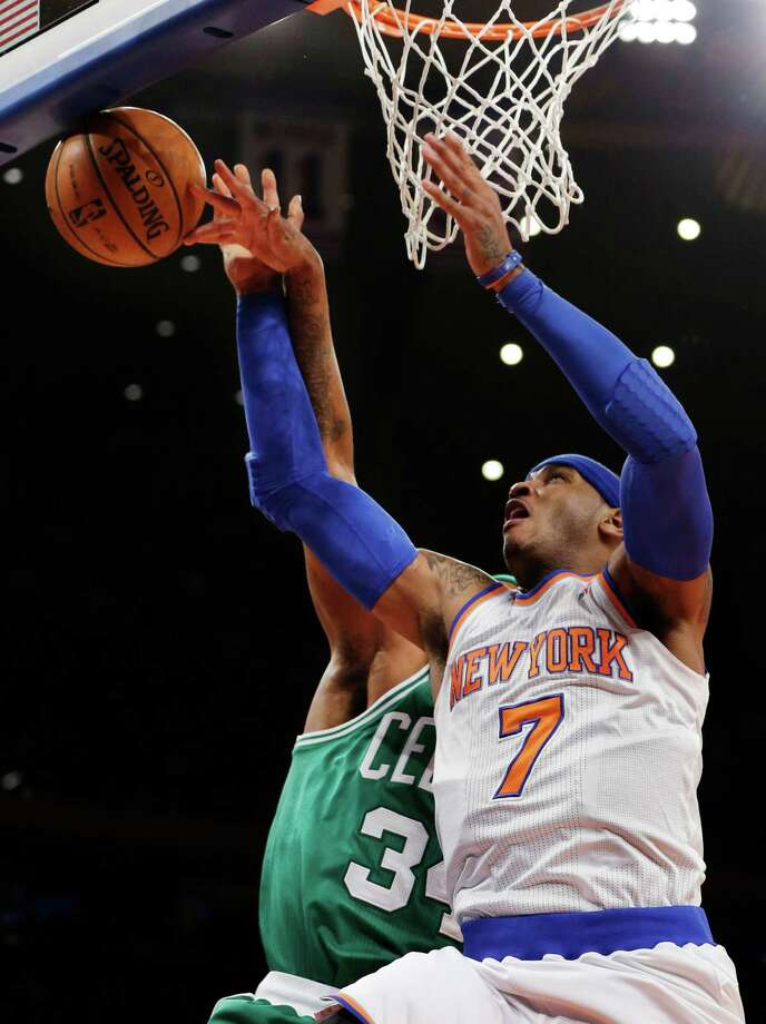 Boston Celtics forward Paul Pierce (34) knocks the ball from the hands of New York Knicks forward Carmelo Anthony (7) in the first half of their NBA basketball game at Madison Square Garden in New York, Monday, Jan. 7, 2013. (AP Photo/Kathy Willens) Photo: Kathy Willens