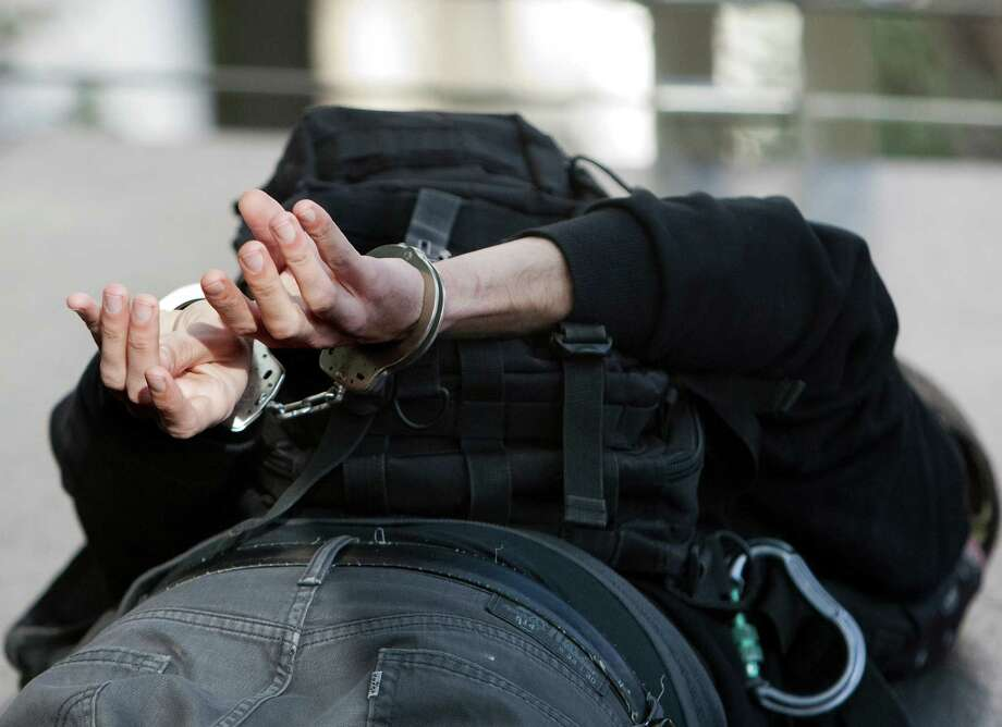 A member of the Tar Sands Blockade is arrested this month in Houston after protesting against TransCanada Corp.'s Keystone XL pipeline. Photo: Cody Duty, Staff / © 2012 Houston Chronicle