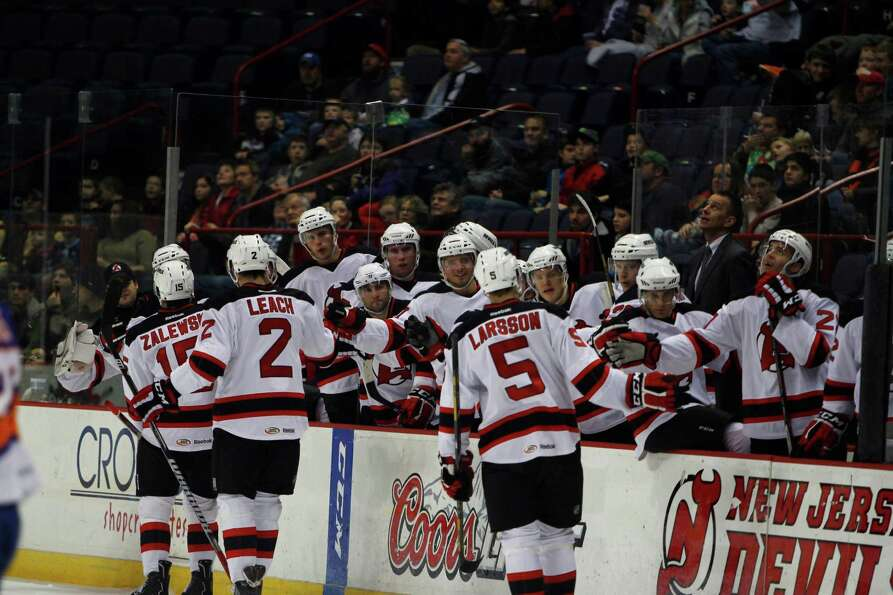 Albany Devils teammates congratulate Adam Larsson (5) after he scored the first goal of the game aga