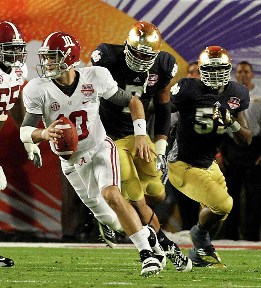 University of Alabama quarterback A.J. McCarron scrambles out of the pocket in the second quarter of the BCS National Championship game against Notre Dame at Sun Life Stadium in Miami Gardens, Florida, on Monday, January 7, 2013. (Charles Trainor Jr./Miami Herald/MCT) Photo: CHARLES TRAINOR JR, McClatchy-Tribune News Service / Miami Herald