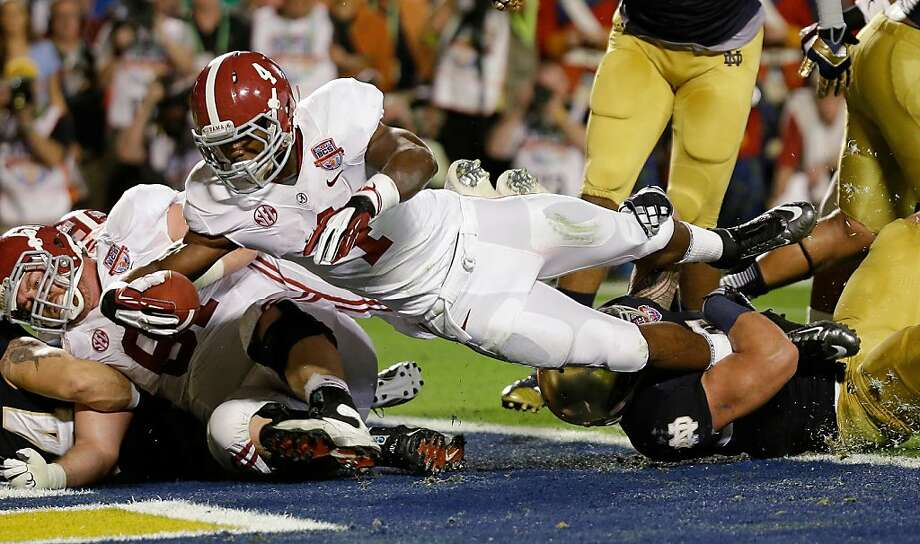 Alabama's T.J. Yeldon (4) dives into the end zone for a touchdown during the first half of the BCS National Championship college football game against Notre Dame Monday, Jan. 7, 2013, in Miami. (AP Photo/David J. Phillip) Photo: David J. Phillip, Associated Press