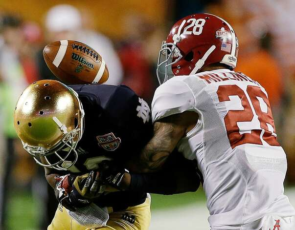 Alabama's Dee Milliner (28) breaks up a pass intended for Notre Dame's DaVaris Daniels during the first half of the BCS National Championship college football game Monday, Jan. 7, 2013, in Miami. (AP Photo/Chris O'Meara) Photo: Chris O'Meara, Associated Press