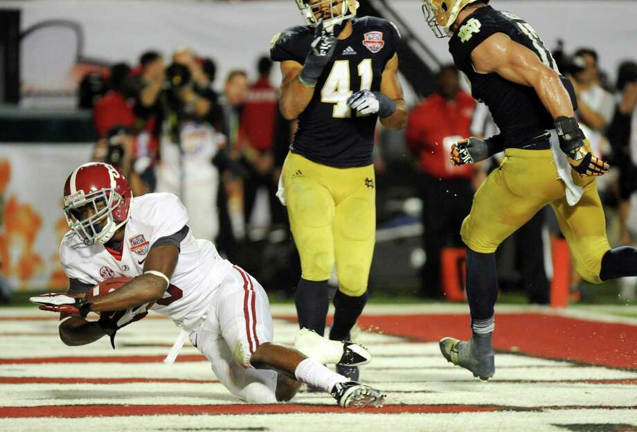 Amari Cooper of Alabama scores a touchdown during the BCS National Championship game against Notre Dame at Sun Life Stadium in Miami Gardens, Florida, on Monday, January 7, 2013. (Jim Rassol/Sun Sentinel/MCT) Photo: Jim Rassol, McClatchy-Tribune News Service / Sun Sentinel