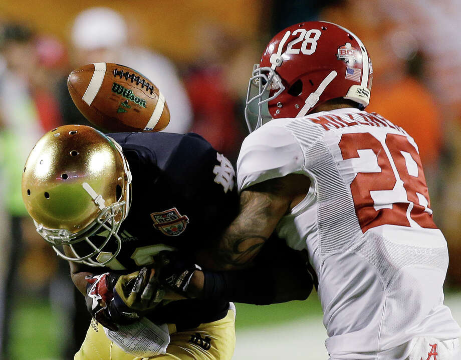 Alabama's Dee Milliner (28) breaks up a pass intended for Notre Dame's DaVaris Daniels during the first half of the BCS National Championship college football game Monday, Jan. 7, 2013, in Miami. (AP Photo/Chris O'Meara) Photo: Chris O'Meara, Associated Press / AP