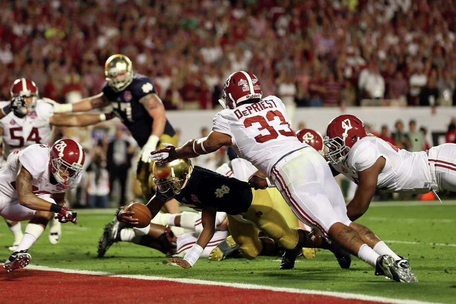 Everett Golson #5 of the Notre Dame Fighting Irish runs for a touchdown in the third quarter against the Alabama Crimson Tide during the 2013 Discover BCS National Championship game at Sun Life Stadium on January 7, 2013 in Miami Gardens, Florida. Photo: Getty Images