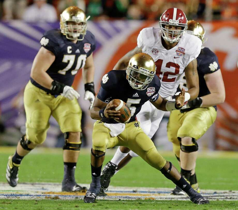 Notre Dame quarterback Everett Golson scrambles during the first half of the BCS National Championship college football game against Alabama Monday, Jan. 7, 2013, in Miami. (AP Photo/Wilfredo Lee) Photo: Wilfredo Lee, Associated Press / AP