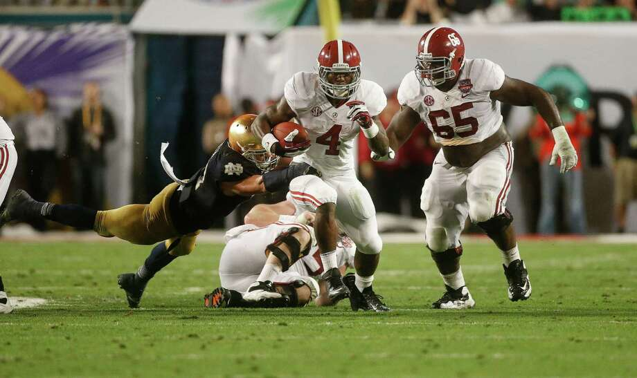 Alabama running back T.J. Yeldon (4) runs against Notre Dame during the first half of the BCS National Championship college football game Monday, Jan. 7, 2013, in Miami. (AP Photo/John Bazemore) Photo: John Bazemore, Associated Press / AP