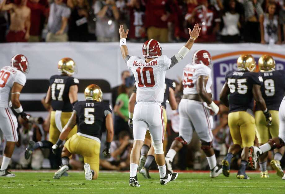 Alabama's AJ McCarron reacts to a touchdown run by Eddie Lacy during the first half of the BCS National Championship college football game against Notre Dame Monday, Jan. 7, 2013, in Miami. (AP Photo/John Bazemore) Photo: John Bazemore, STF / AP