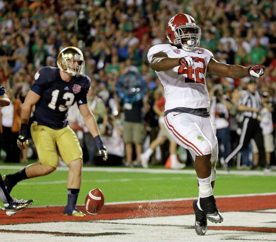 Alabama's Eddie Lacy (42) reacts after rushing for a touchdown during the first half of the BCS National Championship college football game against Notre Dame Monday, Jan. 7, 2013, in Miami. (AP Photo/David J. Phillip) Photo: David J. Phillip, STF / AP
