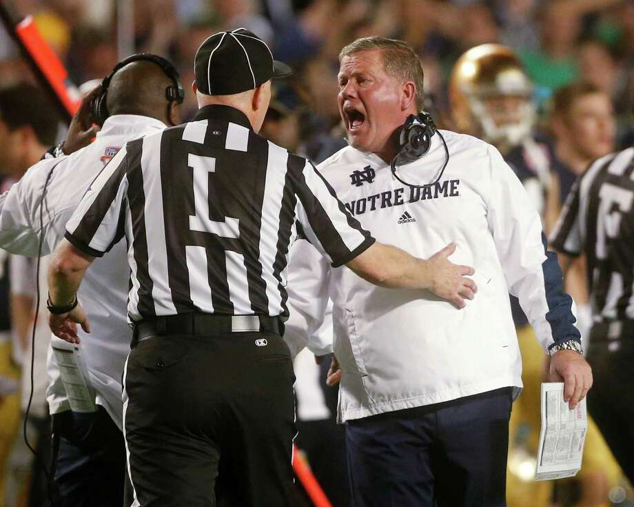 Notre Dame head coach Brian Kelly argues a call during the first half of the BCS National Championship college football game against Alabama Monday, Jan. 7, 2013, in Miami. (AP Photo/John Bazemore) Photo: John Bazemore, STF / AP