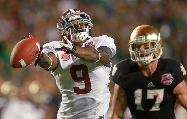 Alabama's Amari Cooper (9) can't come up with a catch in front of Notre Dame 's Zeke Motta (17) during the first half of the BCS National Championship college football game Monday, Jan. 7, 2013, in Miami. (AP Photo/John Bazemore) Photo: John Bazemore, Associated Press / AP