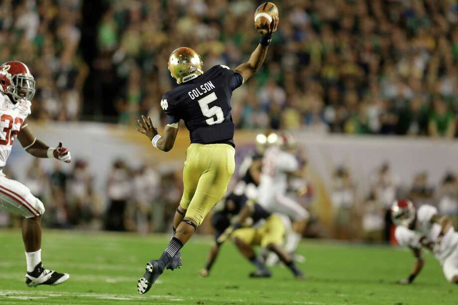 Notre Dame quarterback Everett Golson (5) throws the ball against Alabama during the first half of the BCS National Championship college football game Monday, Jan. 7, 2013, in Miami. (AP Photo/John Bazemore) Photo: John Bazemore, Associated Press / AP