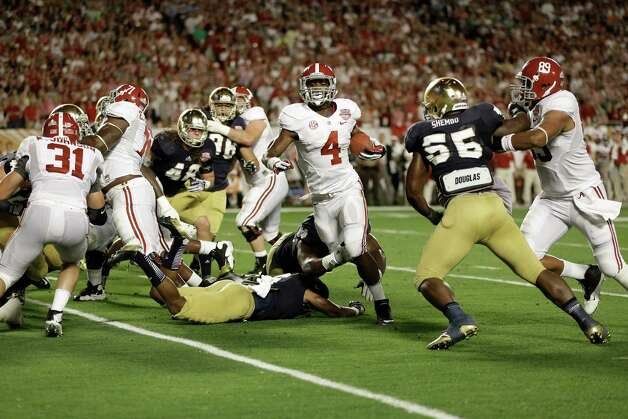 Alabama running back T.J. Yeldon (4) runs against Notre Dame during the first half of the BCS National Championship college football game Monday, Jan. 7, 2013, in Miami. (AP Photo/Chris O'Meara) Photo: Chris O'Meara, Associated Press / AP