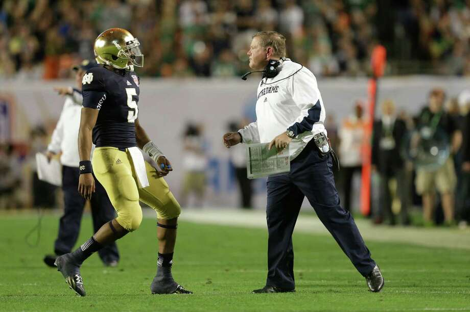 Notre Dame quarterback Everett Golson (5) speaks to Notre Dame head coach Brian Kelly during the second half of the BCS National Championship college football game against Alabama, Monday, Jan. 7, 2013, in Miami. (AP Photo/Wilfredo Lee) Photo: Wilfredo Lee, Associated Press / AP