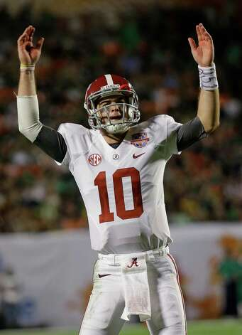 Alabama quarterback AJ McCarron celebrates during the second half of the BCS National Championship college football game against Notre Dame Monday, Jan. 7, 2013, in Miami. (AP Photo/David J. Phillip) Photo: David J. Phillip, Associated Press / AP