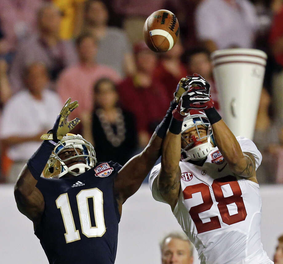 Alabama's Dee Milliner (28) breaks up a pass intended for Notre Dame's DaVaris Daniels (10) during the second half of the BCS National Championship college football game Monday, Jan. 7, 2013, in Miami. (AP Photo/Wilfredo Lee) Photo: Wilfredo Lee, Associated Press / AP