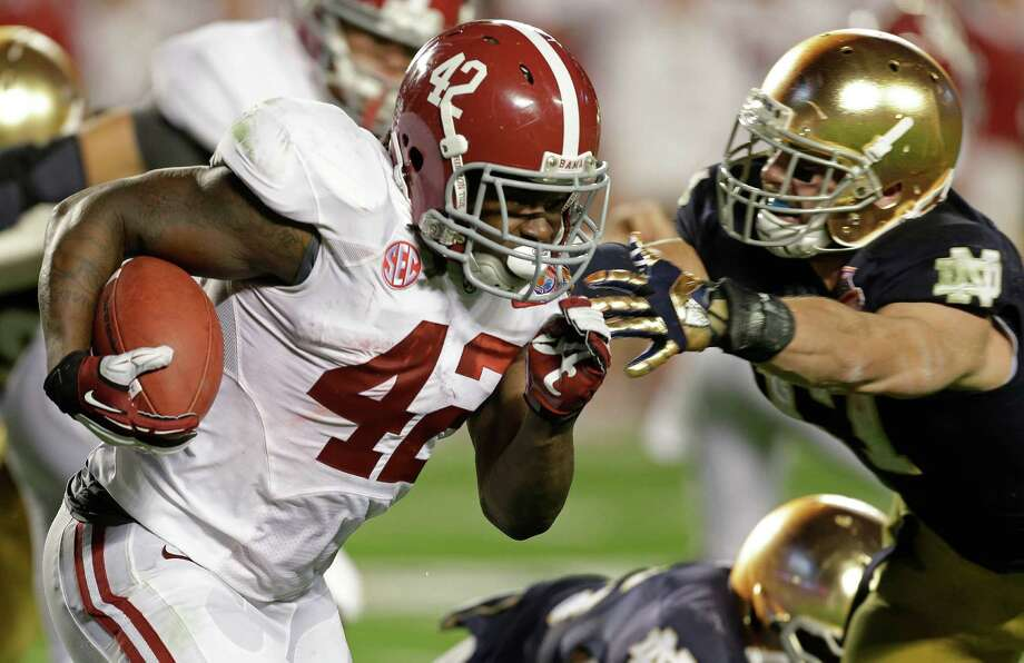Alabama's Eddie Lacy runs during the first half of the BCS National Championship college football game against Notre Dame Monday, Jan. 7, 2013, in Miami. (AP Photo/Chris O'Meara) Photo: Chris O'Meara, Associated Press / AP