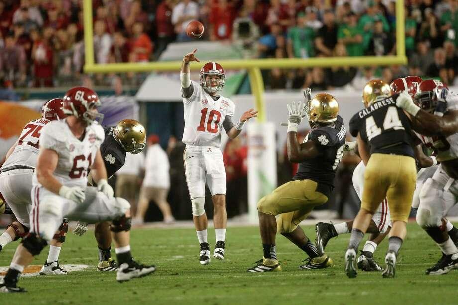 Alabama quarterback AJ McCarron (10) works against Notre Dame during the first half of the BCS National Championship college football game Monday, Jan. 7, 2013, in Miami. (AP Photo/John Bazemore) Photo: John Bazemore, Associated Press / AP