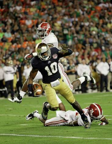 Notre Dame wide receiver DaVaris Daniels (10) makes a catch against Alabama during the second half of the BCS National Championship college football game Monday, Jan. 7, 2013, in Miami. (AP Photo/David J. Phillip) Photo: David J. Phillip, Associated Press / AP