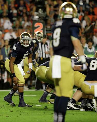 Notre Dame quarterback Everett Golson (5) works against Alabama during the first half of the BCS National Championship college football game Monday, Jan. 7, 2013, in Miami. (AP Photo/David J. Phillip) Photo: David J. Phillip, Associated Press / AP
