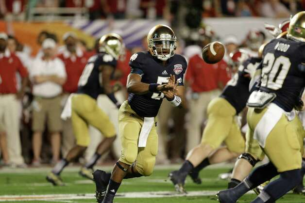 Notre Dame quarterback Everett Golson (5) tosses the ball out against Alabama during the first half of the BCS National Championship college football game Monday, Jan. 7, 2013, in Miami. (AP Photo/Chris O'Meara) Photo: Chris O'Meara, Associated Press / AP