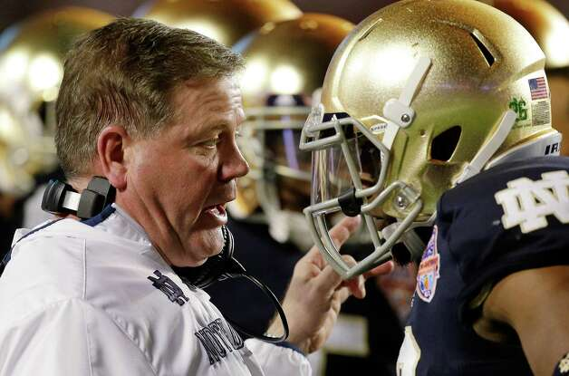 Notre Dame head coach Brian Kelly talks to Robby Toma during the first half of the BCS National Championship college football game against Alabama Monday, Jan. 7, 2013, in Miami. (AP Photo/Chris O'Meara) Photo: Chris O'Meara, Associated Press / AP