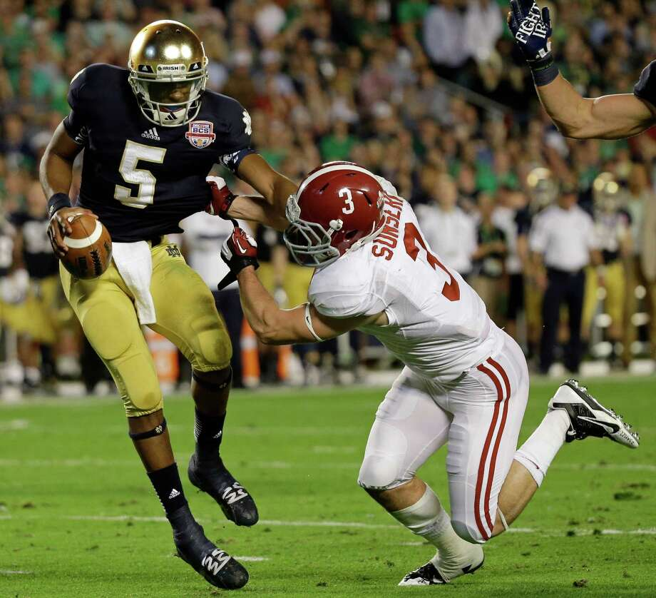 Notre Dame quarterback Everett Golson (5) tries to get away from Alabama's Vinnie Sunseri (3) during the first half of the BCS National Championship college football game Monday, Jan. 7, 2013, in Miami. (AP Photo/David J. Phillip) Photo: David J. Phillip, Associated Press / AP