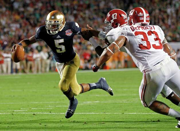 Notre Dame quarterback Everett Golson (5) runs past Alabama's Xzavier Dickson (47) and Trey DePriest (33) for a touchdown during the second half of the BCS National Championship college football game Monday, Jan. 7, 2013, in Miami. (AP Photo/Wilfredo Lee) Photo: Wilfredo Lee, Associated Press / AP