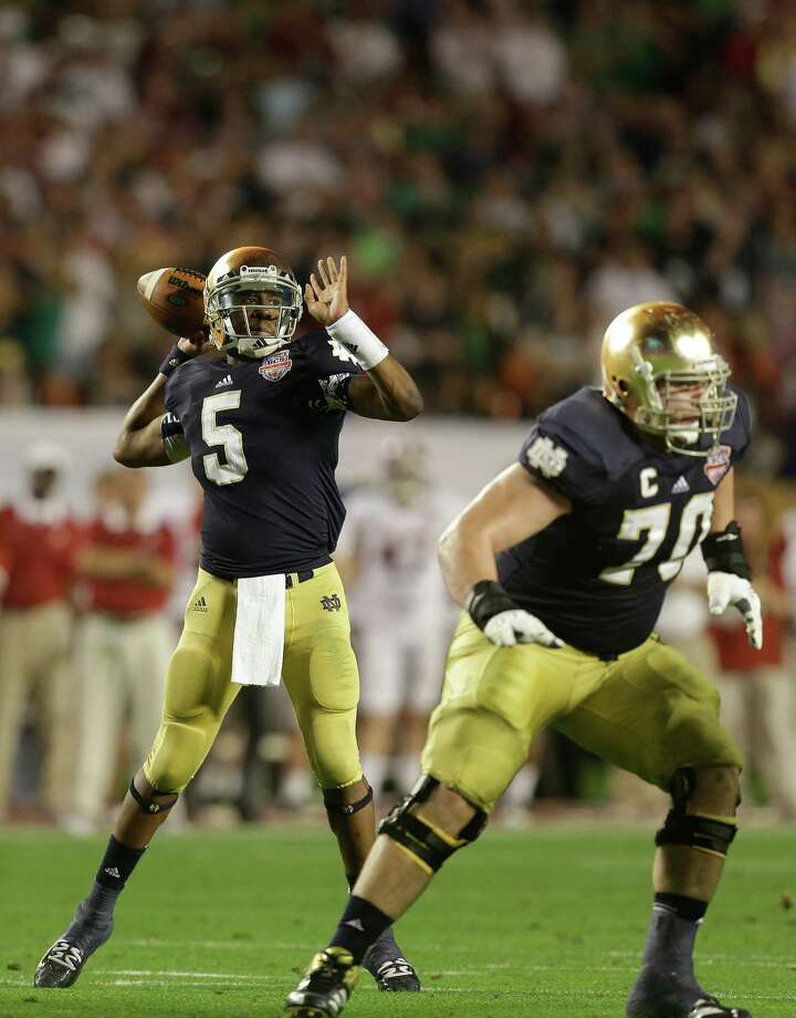 Notre Dame quarterback Everett Golson (5) works as Notre Dame offensive tackle Zack Martin (70) blocks against Alabama during the second half of the BCS National Championship college football game Monday, Jan. 7, 2013, in Miami. (AP Photo/Wilfredo Lee) Photo: Wilfredo Lee, Associated Press / AP