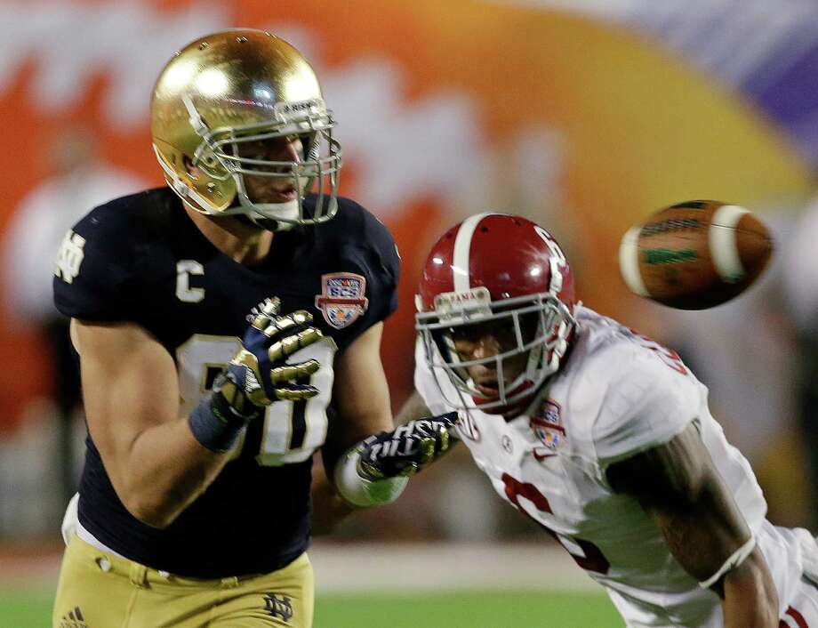 Notre Dame's Tyler Eifert (80) catches a pass in front of Alabama's Ha'Sean Clinton-Dix (6) during the second half of the BCS National Championship college football game Monday, Jan. 7, 2013, in Miami. (AP Photo/Chris O'Meara) Photo: Chris O'Meara, Associated Press / AP