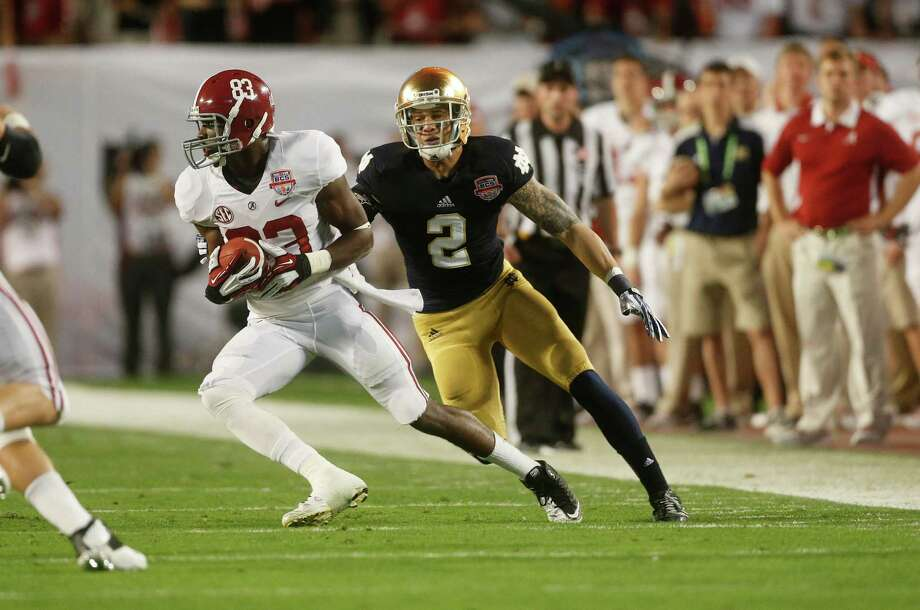 Alabama wide receiver Kevin Norwood (83) works against Notre Dame cornerback Bennett Jackson (2) during the first half of the BCS National Championship college football game Monday, Jan. 7, 2013, in Miami. (AP Photo/John Bazemore) Photo: John Bazemore, Associated Press / AP