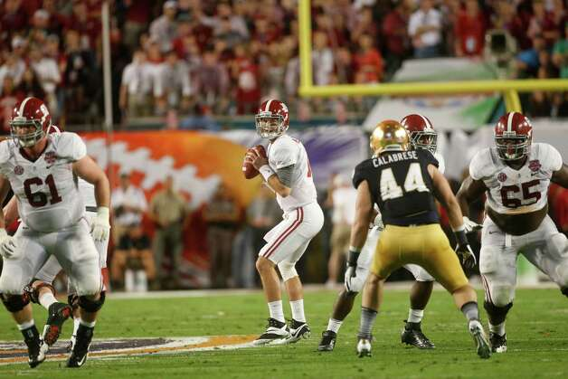 Alabama quarterback AJ McCarron (10) works against Notre Dame during the first half of the BCS National Championship college football game Monday, Jan. 7, 2013, in Miami. (AP Photo/John Bazemore) Photo: John Bazemore, Associated Press / AP