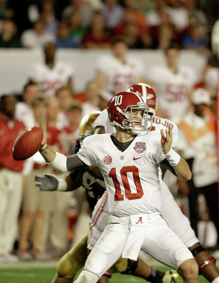 Alabama quarterback AJ McCarron (10) works against Notre Dame during the first half of the BCS National Championship college football game Monday, Jan. 7, 2013, in Miami. (AP Photo/Chris O'Meara) Photo: Chris O'Meara, Associated Press / AP