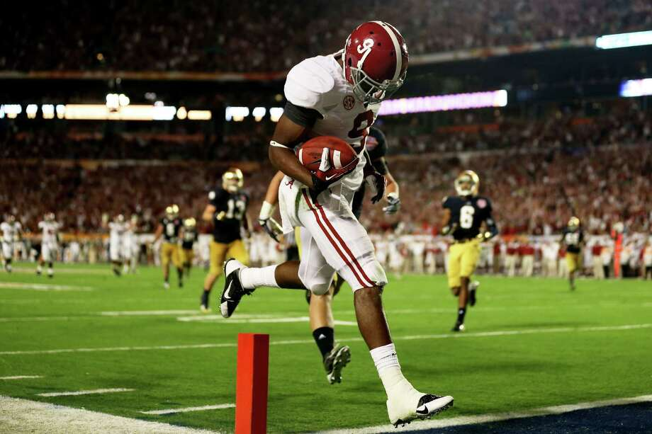 Amari Cooper #9 of the Alabama Crimson Tide scores a touchdown in the third quarter against the Notre Dame Fighting Irish during the 2013 Discover BCS National Championship game at Sun Life Stadium on January 7, 2013 in Miami Gardens, Florida. Photo: Getty Images