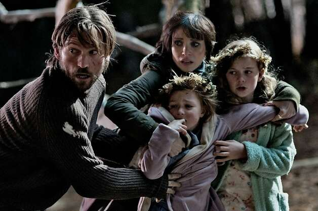 "Nikolaj Coster-Waldau, Jessica Chastain, Megan Charpentier (right) and Isabelle Nelisse in ""Mama."" Photo: George Kraychyk, Universal Pictures"